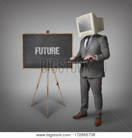 Tech trends text on blackboard and computer monitor on businessman head