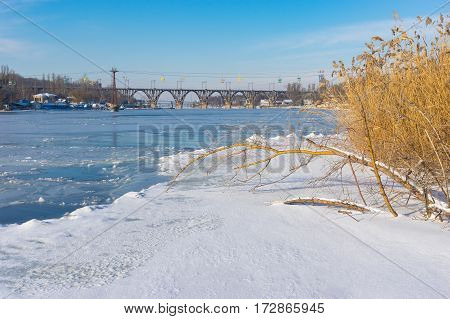 Frozen and snow covered river Dnepr in the central part of the same name Ukrainian city