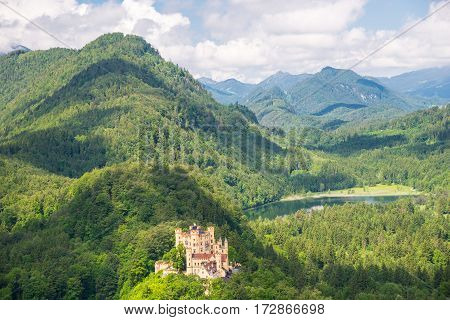 Castle Hohenschwangau, Eternal Forest With Mountains Of Bavaria, Germany.