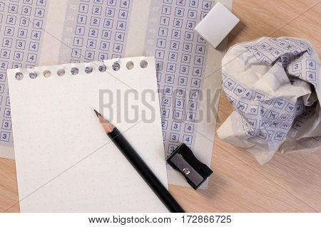 Crumpled Paper Ball Of Vintage Classic Answer Sheet With Pencil, Sharpener And Paper Reduction. Cros
