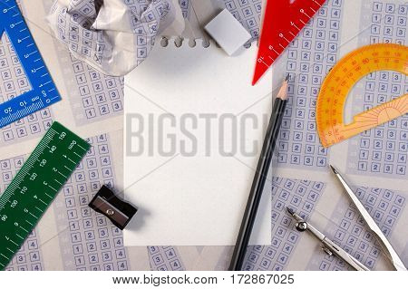 Blank Paper Reduction On Vintage Answer Sheet With Pencil, Sharpener And Drawing Compasses On Set Of