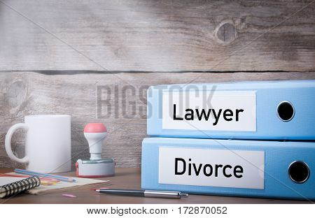 Divorce and Lawyer. Two binders on desk in the office. Business background.