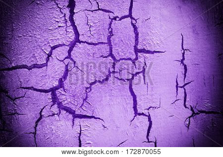 Old Damaged Cracked Paint Wall, Grunge Background, violet color, horizontal
