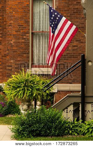 American flag on a porch for various National holidays
