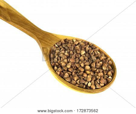 Buckwheat in wooden spoon on a white background