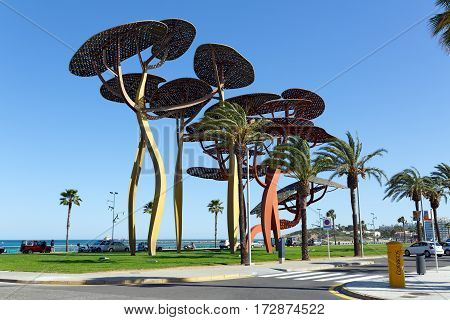 LA PINEDA/ SPAIN - MAY 15. The pine tree sculpture on the seafront promenade on May 15, 2015 in La Pineda, Spain.