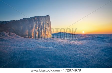 Ice block closeup during sunset. Image taken on a ice by the lake.