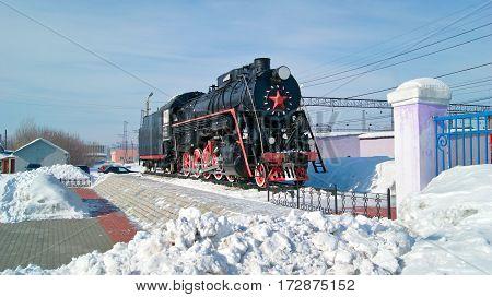 KAMENSK-URALSKIY/ RUSSIA - FEBRUARY 4. Old russian freight locomotive L-4305 on railway station square of the city Kamensk-Uralsky on February 4, 2011. Sverdlovsk region, Russia