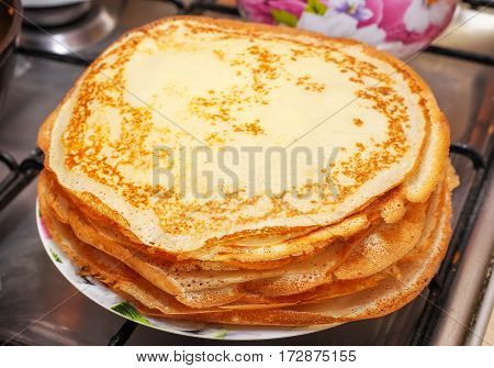 Stack of delicious fried pancakes on a plate. Maslenitsa Festival