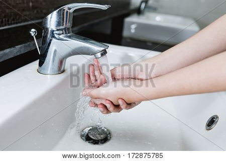 Close-up Washing Of Hands Under The Crane With Water