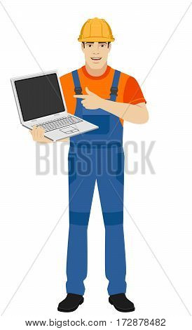 Builder pointing the finger to laptop. Full length portrait of builder in a flat style. Vector illustration.