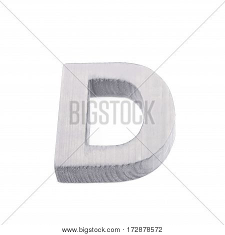 Single sawn wooden letter D symbol coated with paint isolated over the white background