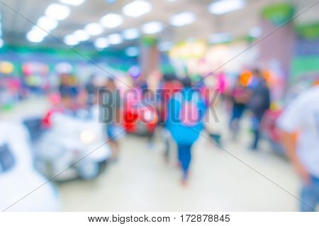Abstract blur people in Interior game zone of shopping center