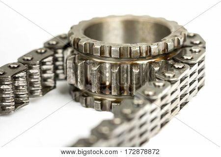 Used Oiled Timing Chain On Crang Shaft Isolated Over White Backg