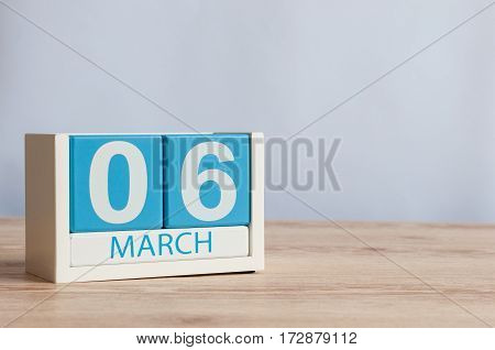 March 6th. Image of march 6 wooden color calendar on white background. Spring day, empty space for text. International Dentist Day.