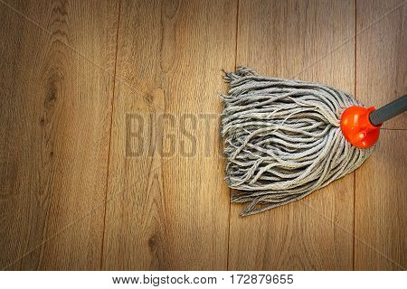 detail of a mop on wooden parquet house working