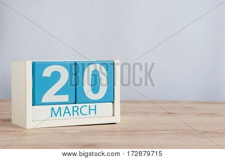 March 20th. Day 20 of month, wooden color calendar on white background. Spring day, empty space for text.