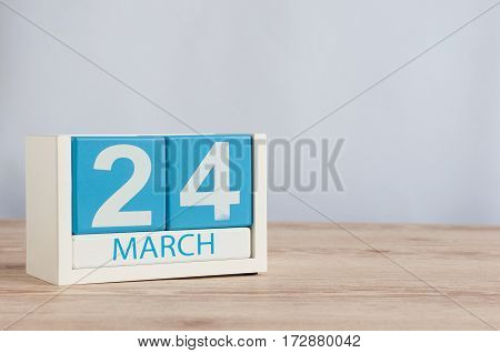 March 24th. Image of march 24 wooden color calendar on white background. Spring day, empty space for text.