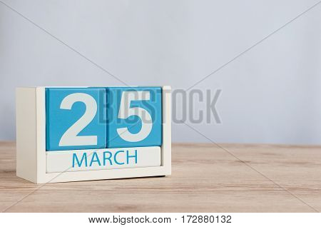 March 25th. Image of march 25 wooden color calendar on white background. Spring day, empty space for text
