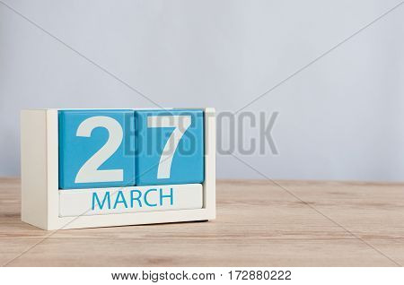 March 27th. Image of march 27 wooden color calendar on white background. Spring day, empty space for text. World Theatre Day.