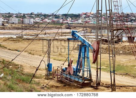 Oil Derrick On Oil Field