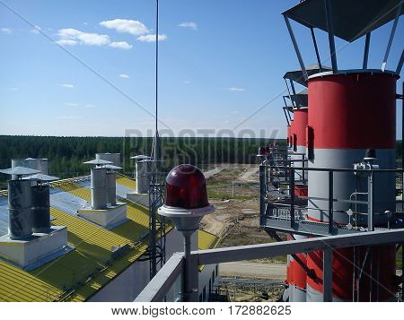 View from top of a chimney in Siberia over the oilfields