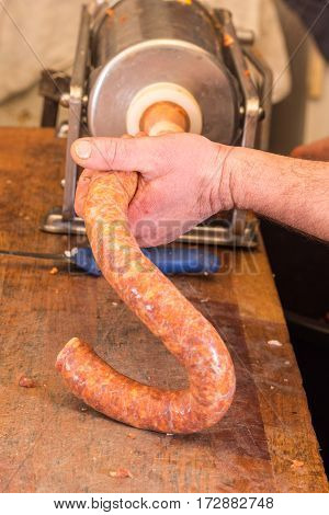 Butcher Making Domestic Sausages With Syringe