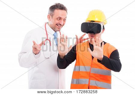 Doctor Looking At Constructor Trying Virtual Reality Glasses
