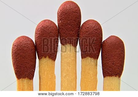 A macro photo of matches head on white background