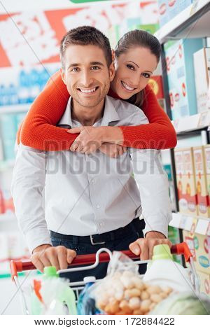 Cheerful Couple Doing Shopping