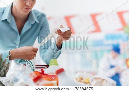 Woman Checking A Long Receipt