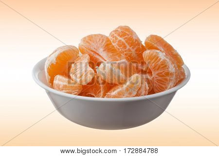 Close-up image of bowl full of oranges on abstract background