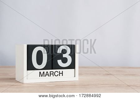 March 3rd. Image of march 3 wooden color calendar on white background. Third spring day, empty space for text.