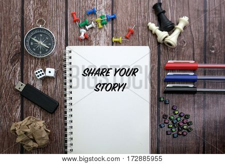 Share your story! CONCEPT ON NOTEBOOK WITH STATIONERY