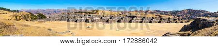 Panorama of Inca Wall in SAQSAYWAMAN Peru South America. Example of polygonal masonry. The famous 32 angles stone in ancient Inca architecture.