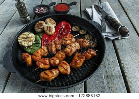 Grilled chicken skewers vegetables and spices on the grill