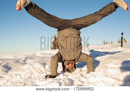 Snowboarder Is Upside Down In The Snow