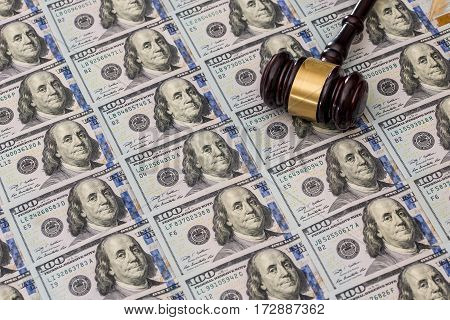 Us Money With Judges Hammer On Wooden Table, Top View.