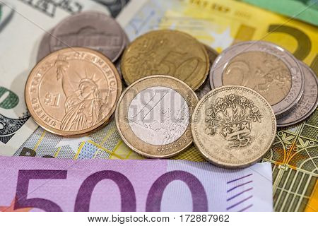 Dollar, Pound, Euro Coin On Euro Background.