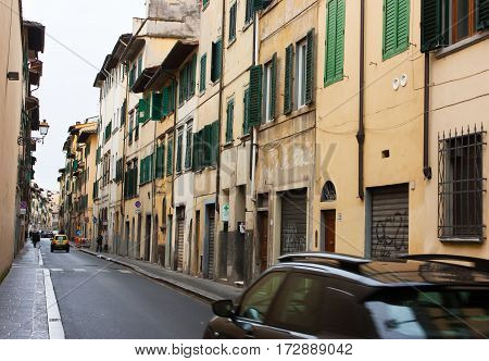 FLORENCE ITALY - FEBRUARY 06 2017: Old streets in Firenze with green shutters