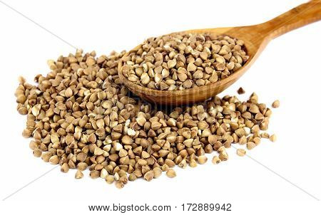 Buckwheat on wooden spoon isolated on white background