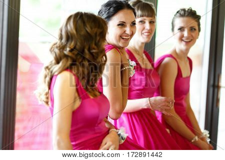 Adorable bridesmaids have fun while waiting for a bride