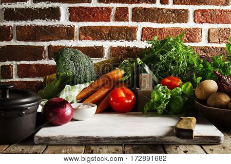 Cooking Healthy Vegetable Detox Concept with Various Vegetables Cooking Pot on Kitchen Table Kitchen Background.