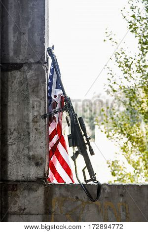 Large caliber sniper rifle with US banner