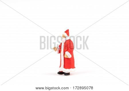 Miniature people Santa Claus on white background with space for text