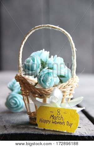 March 8 greeting card. International Womans Day. Beautiful bouquet of blue flowers in basket and tag.