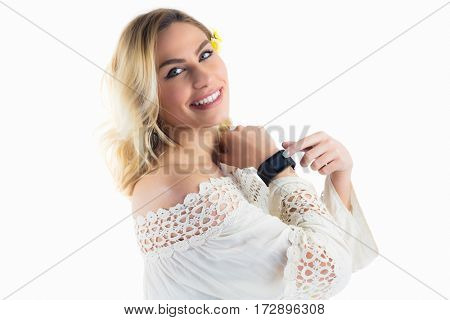 Portrait of beautiful woman posing with smartwatch against white background