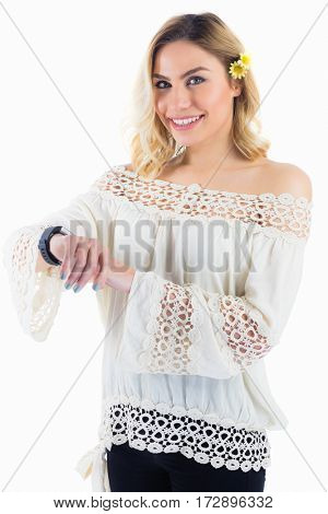 Portrait of beautiful woman with smartwatch against white background