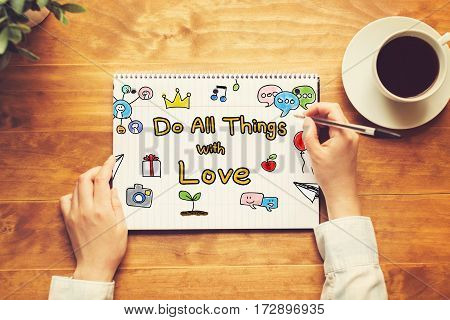 Do All Things With Love Text With A Person Holding A Pen