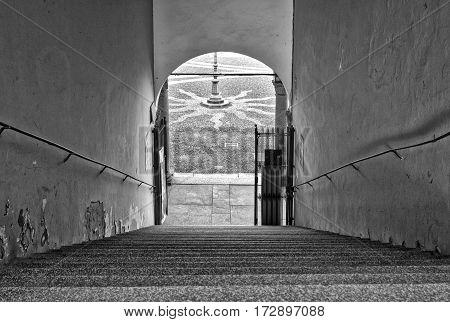 The marble staircase at the entrance of Ducale palace in Vigevano (Lombardy, Northern Italy). Black and white photo.